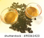 coffee and black coffee beans | Shutterstock . vector #690361423
