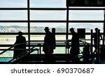 silhouette 3 rabbi walking in ... | Shutterstock . vector #690370687