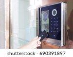 electronic door lock opening by ... | Shutterstock . vector #690391897