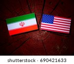 iranian flag with usa flag on a ... | Shutterstock . vector #690421633