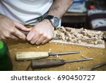 wood engraver at work for... | Shutterstock . vector #690450727
