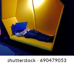 people take a short sleep after ... | Shutterstock . vector #690479053