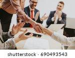 business people shaking hands... | Shutterstock . vector #690493543