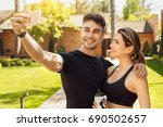 young couple exercise together... | Shutterstock . vector #690502657