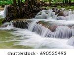 huay mae kamin waterfall in... | Shutterstock . vector #690525493