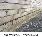 Small photo of Line of bitumen damp proof course in a brick wall