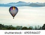 hot air balloons landing in a... | Shutterstock . vector #690546637