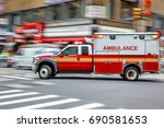 Small photo of ambulance on emergency car in motion blur