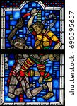 Small photo of WORMS, GERMANY - JULY 4, 2017: Stained Glass in Wormser Dom in Worms, Germany, depicting the Murder of Abel by Cain