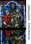 Small photo of WORMS, GERMANY - JULY 4, 2017: Stained Glass in Wormser Dom in Worms, Germany, depicting the Works of mercy, here: feed the hungry