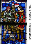 Small photo of WORMS, GERMANY - JULY 4, 2017: Stained Glass in Wormser Dom in Worms, Germany, depicting the corporal Works of mercy, here: shelter the homeless