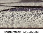 Small photo of Old flexible tile roof of the house. Small depth of field. The surface of the tile has an inhomogeneous structure
