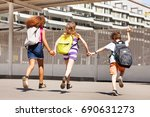 three kids run to school view... | Shutterstock . vector #690631273