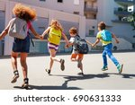 kids with backpacks run to... | Shutterstock . vector #690631333