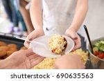 volunteer sharing food with... | Shutterstock . vector #690635563