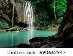 waterfall with teal water ... | Shutterstock . vector #690662947