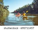 man paddling in a kayak on... | Shutterstock . vector #690711457