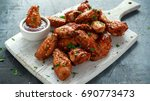 baked chicken wings with sesame ...   Shutterstock . vector #690773473