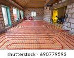 pipefitter installing system of ... | Shutterstock . vector #690779593