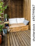 wooden pallet couch on balcony | Shutterstock . vector #690799867