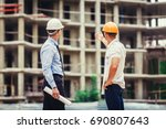 architect and builder... | Shutterstock . vector #690807643