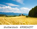 rye field and chapel on the... | Shutterstock . vector #690826297