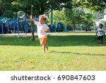 little boys are running in the...   Shutterstock . vector #690847603