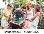 barbecue time.young family make ... | Shutterstock . vector #690849823