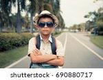 portrait asian boy tourist with ... | Shutterstock . vector #690880717