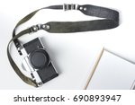 vintage camera with strap and... | Shutterstock . vector #690893947