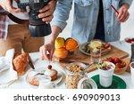 photographer shooting food on... | Shutterstock . vector #690909013