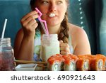 woman in the restaurant eats... | Shutterstock . vector #690921643