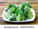 fresh frozen broccoli on white... | Shutterstock . vector #690929593