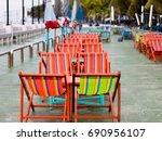 beach chairs and umbrellas... | Shutterstock . vector #690956107