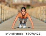 young woman exercising outdoor... | Shutterstock . vector #69096421