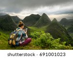 a traveler with a smartphone is ... | Shutterstock . vector #691001023