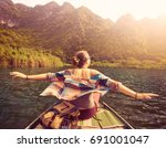 happy tourist travels by boat...   Shutterstock . vector #691001047