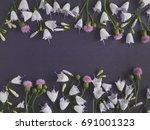dark floral background. frame... | Shutterstock . vector #691001323