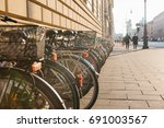 many bikes in a row on the... | Shutterstock . vector #691003567