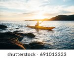 man paddling the kayak at... | Shutterstock . vector #691013323
