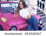 fashion outdoor photo of...   Shutterstock . vector #691020067