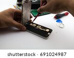 on the desk repairman preparing ... | Shutterstock . vector #691024987