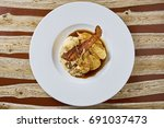 beautiful and tasty food on a... | Shutterstock . vector #691037473