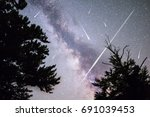 a view of a meteor shower and... | Shutterstock . vector #691039453