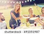 friends having barbecue party...   Shutterstock . vector #691051987