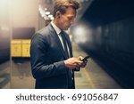 young businessman wearing... | Shutterstock . vector #691056847