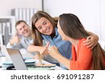happy colleagues congratulating ... | Shutterstock . vector #691091287