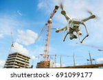 drone over construction site.... | Shutterstock . vector #691099177