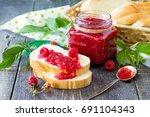 homemade jam. glass jar with...   Shutterstock . vector #691104343