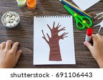 the child cuts out the details...   Shutterstock . vector #691106443